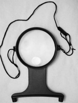 Hands free neck magnifier with insert lens